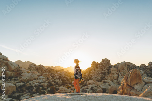 USA, California, Woman standing on rocks in Joshua Tree National Park