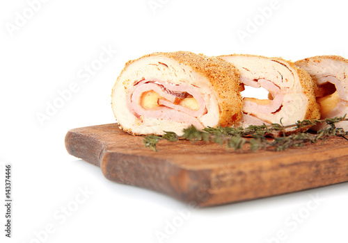Photo  Wooden board with tasty chicken sliced roll on white background