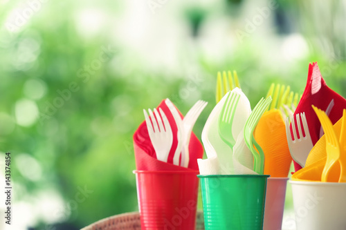 Aluminium Prints Picnic Plastic ware for picnic on blurred background