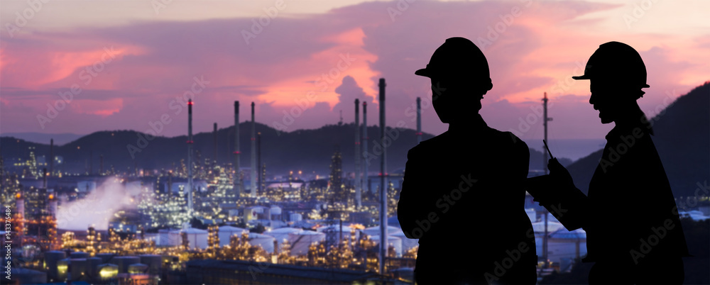 Fototapety, obrazy: Silhouette engineers are standing orders The oil refining industry
