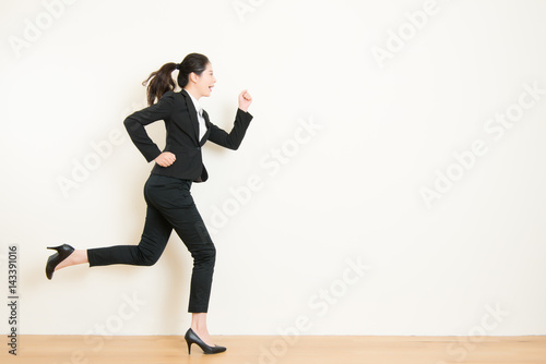 Fotografie, Obraz  Young businesswoman with running on white background
