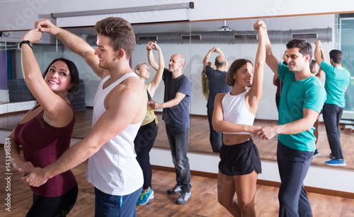 Fotografía Adults dancing bachata together in dance studio