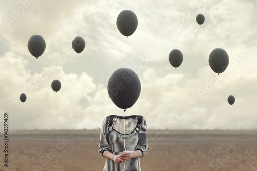 Photo  surreal image of woman and blacks balloons flying