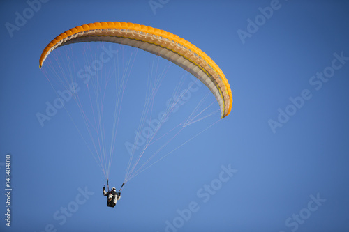 Spoed Foto op Canvas Luchtsport Paraglider flying over mountains.