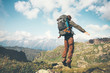 Happy Man jumping levitation with heavy backpack at mountains Lifestyle Travel emotional euphoria success concept adventure active vacations outdoor .