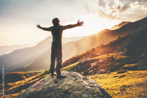 Fotografie, Obraz  Happy Man raised hands at sunset mountains Travel Lifestyle emotional concept ad