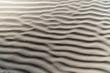 Texture wavy sand beach.
