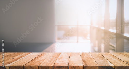 Wood Table Top With Blur Sunlight In Glass Window In Room Building  Background.For Montage