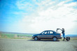 woman rolls car wheel
