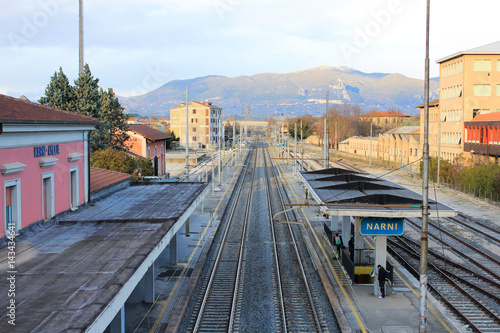 Foto auf AluDibond Bahnhof The medieval village of Narni seen from the train station and the industrial distracted in the valley, Umbria, Italy