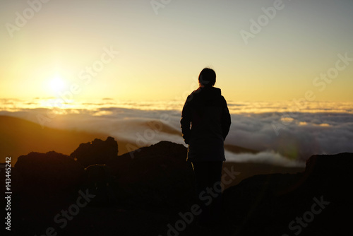 Silhouette Person Against Cloudy Sky During Sunset