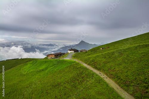 Poster Donkergrijs Foggy landscape in the Alps mountains, Tirol, Austria. At the background is Kitzbuhel peak.
