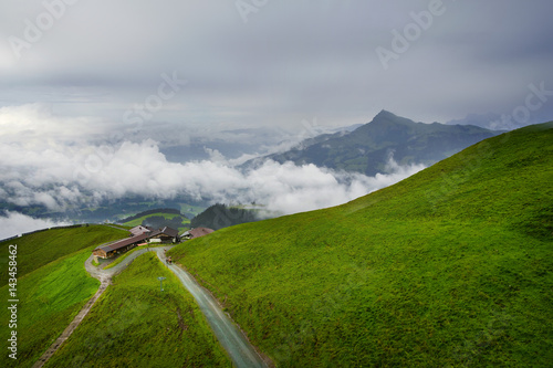 Staande foto Donkergrijs Foggy landscape in the Alps mountains, Tirol, Austria. At the background is Kitzbuhel peak.