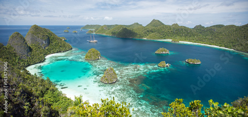 Scenic view of Wayag Islands and sailing boat Lamima Raja Ampat Indonesia