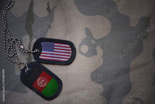 army blank, dog tag with flag of united states of america and afghanistan on the khaki texture background Fototapet