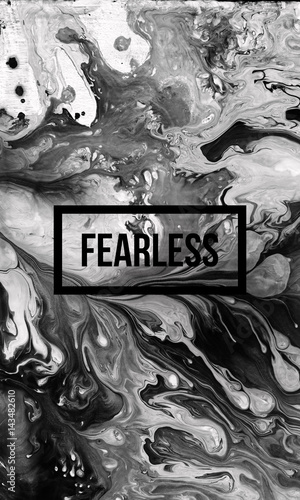 Photo  Fearless motivational quote on abstract liquid background.