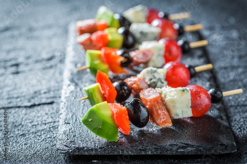 Murais de parede Closeup of tasty finger food with vegetables and herbs