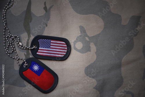 Fotografie, Tablou  army blank, dog tag with flag of united states of america and taiwan on the khaki texture background