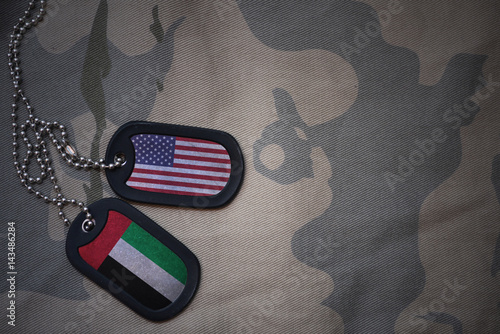 army blank, dog tag with flag of united states of america and united arab emirates on the khaki texture background Tablou Canvas