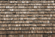 Weathered Wooden Shingles On A Roof. Wooden Roof Tile Of Old House
