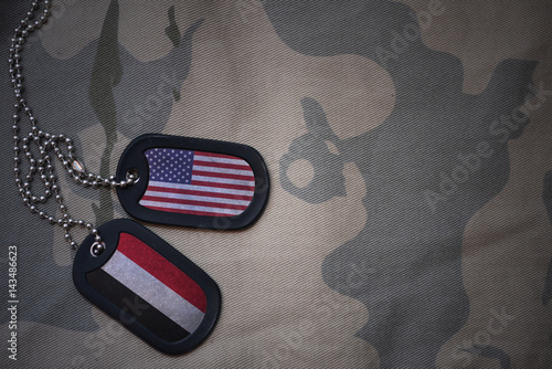 army blank, dog tag with flag of united states of america and yemen on the khaki texture background Tablou Canvas