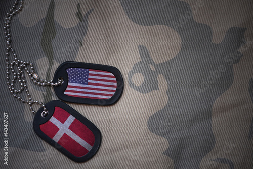 army blank, dog tag with flag of united states of america and denmark on the khaki texture background Fototapet
