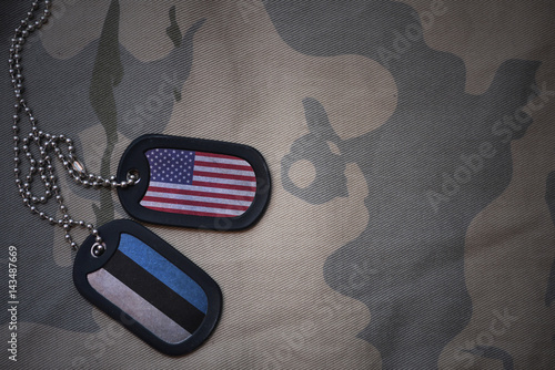 Fotografie, Tablou  army blank, dog tag with flag of united states of america and estonia on the khaki texture background