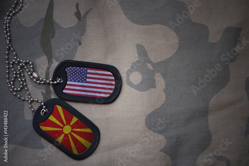 army blank, dog tag with flag of united states of america and macedonia on the khaki texture background Fototapet