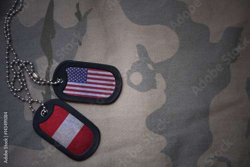 army blank, dog tag with flag of united states of america and peru on the khaki texture background Fototapet