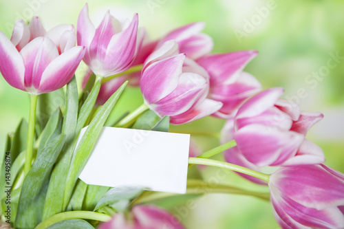 Valokuva  Fresh Flowers with Blank Note Card