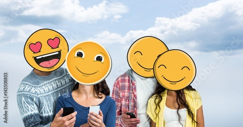 Men and women with mobile phones and emojis over face Wallpaper Mural