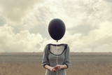 woman's head replaced by a black balloon - 143522207