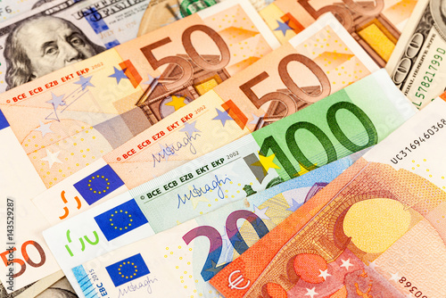 Background Of Different Currency Euro Banknotes And American Dollars