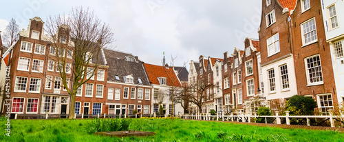 Photo  Dutch traditional Holland houses in Amsterdam, Netherlands panoramic banner