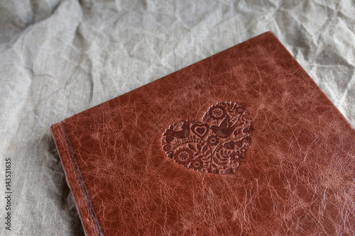 Valokuva  Photo book with a cover of genuine leather