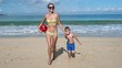 Mother and Son Playing With a Ball on a Beach