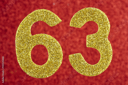 Fotografie, Tablou  Number sixty-three yellow color over a red background