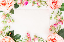 Floral Frame Of Pink Roses And Paper Card For Calligraphy On White Background. Flat Lay, Top View. Art Background.