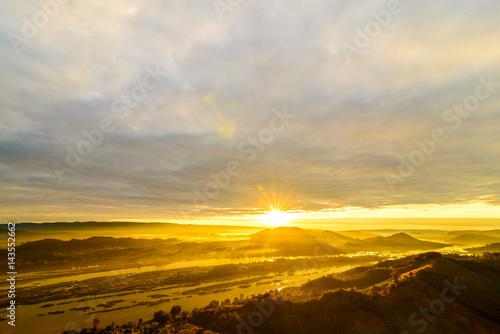 Poster Bleu nuit Landscape of golden sunrise morning with fog on mountain