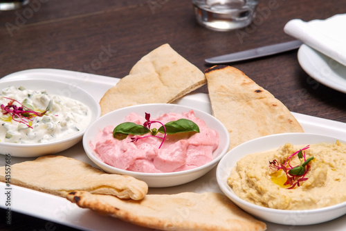 Photo sur Aluminium Entree restaurant starter meal of a sharing platter of dips with bread