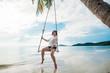 Happy woman on a swing tropical island