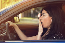 Sleepy Yawning Woman Driving Her Car After Long Hour Trip.