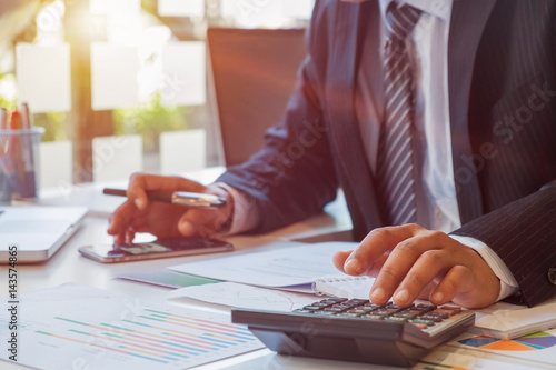 Business man calculating budget numbers, Invoices and financial adviser working Canvas Print