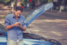 Upset Man Texting Roadside Assistance After Breaking Down