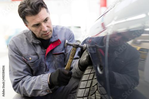 Foto op Aluminium Graffiti Auto mechanic repairing car. Selective focus.