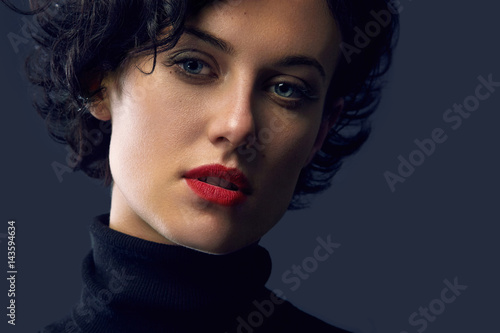 Fototapety, obrazy: Brunette woman with curly Hair on dark background. Copy Space. Stylish and fashionable concept.