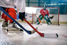 Ice Hockey Player In Action Kicking With Stick .