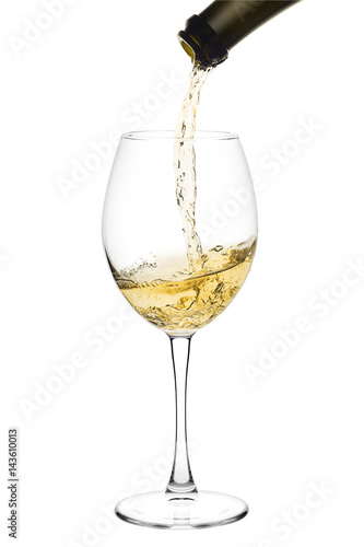 Fototapeta white wine poured from a bottle into wine glass on white background, isolated obraz