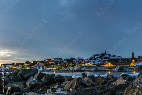 Deurstickers Poolcirkel Nuuk city old harbor sunset view with stones and icebergs, Greenland