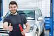 Professional car mechanic with his tools at the car repair shop